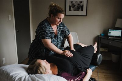 Pregnant woman received a prenatal chiropractic treamtnet in preparation for labour