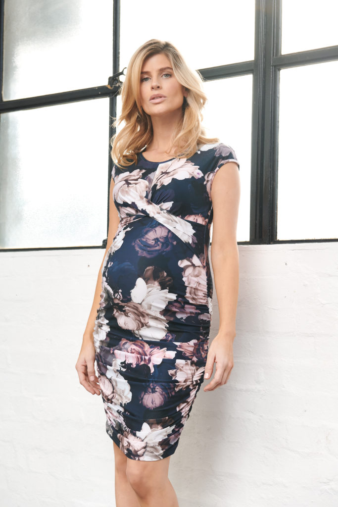 Woman wearing dress by Maternity clothing rentals company