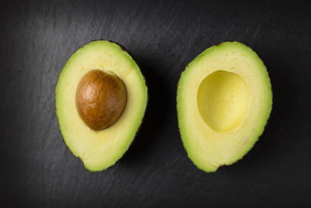Avocado cleaved in half