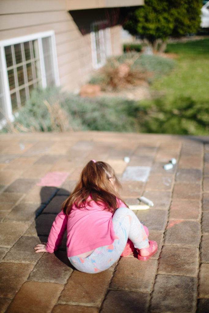 outdoor play | playing outside with chalk | West End Mamas
